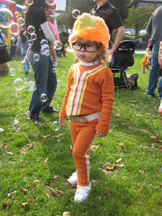 "DJ LANCE ROCK (2007): Costume wearer Masey, 2 years old when this was taken, specifically asked to be DJ Lance Rock from the kids' TV show ""Yo Gabba Gabba."" We're hoping she repurposes the belt buckle for a future prom/wedding."