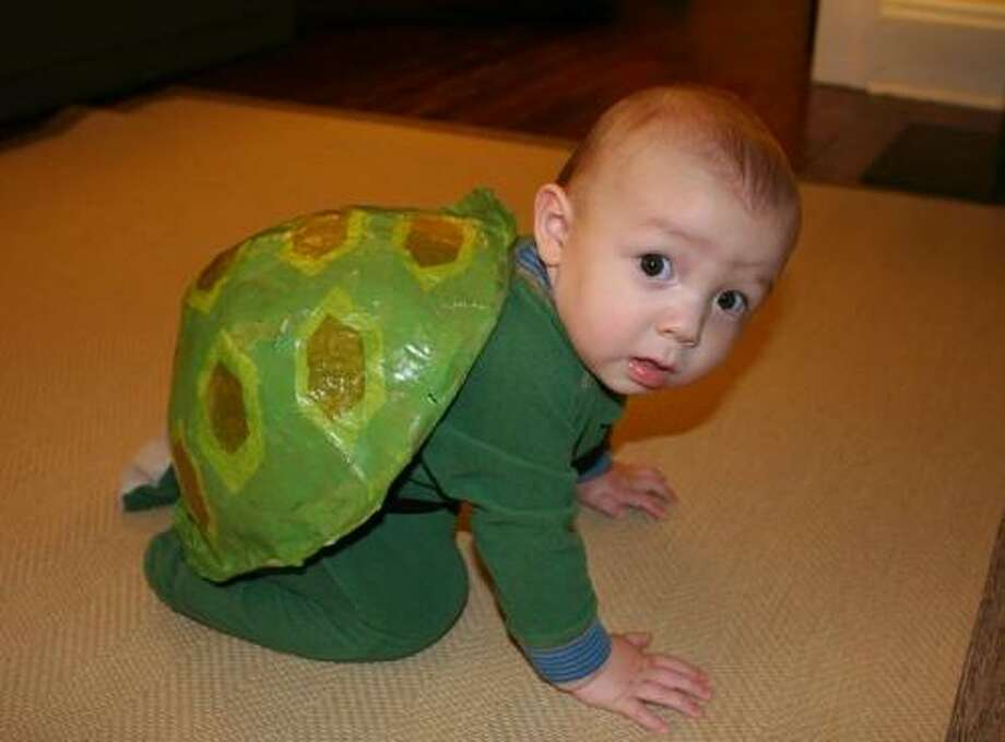 """TURTLE (2008): This costume was undeniably adorable. From mother Janelle: """"Alex was a little turtle for his first Halloween. I figured that since it is the only Halloween where he will crawl, a turtle would be a good option."""""""