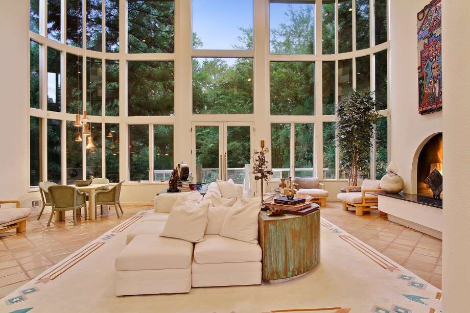 Living area with windows forever. Photo via Atlanta Fine Homes
