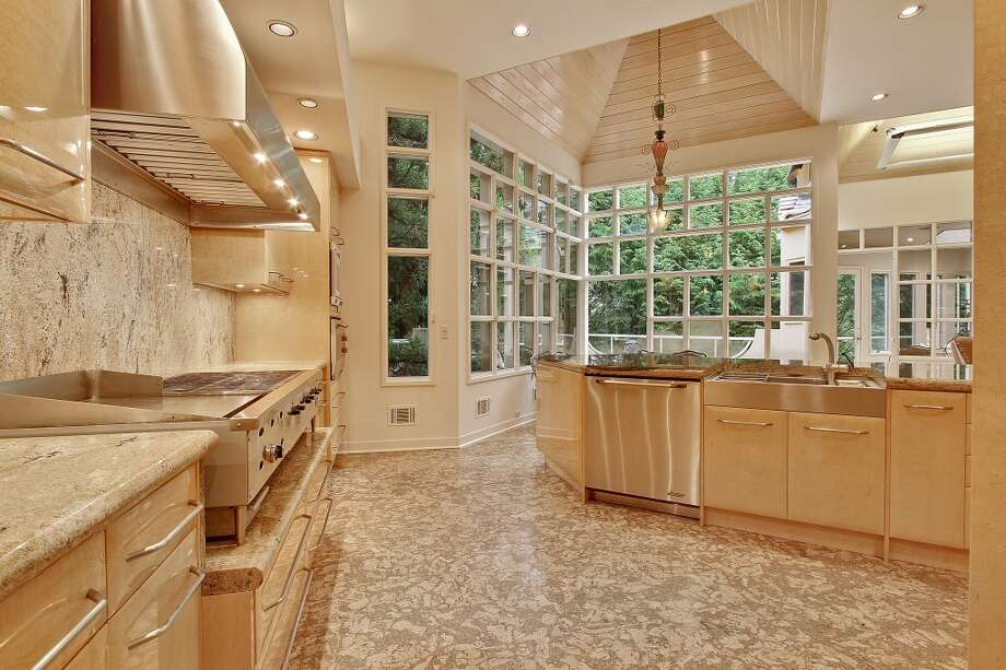 Pale, palatial kitchen. Photo via Atlanta Fine Homes