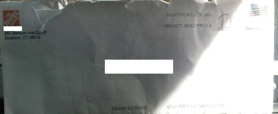 This envelope, with victim information blocked out, was sent to a Milford resident with a pornographic photo inside, police say. Photo: Contributed Photo / Connecticut Post Contributed