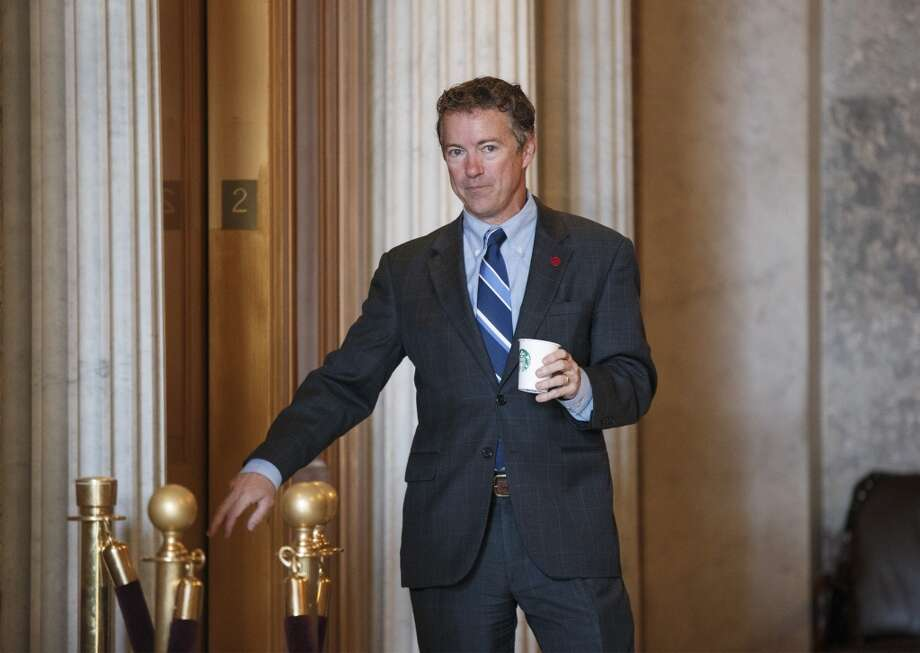 "Sen. Rand Paul, R-Kentucky:  ""If we don't raise the debt ceiling, what that means is you have a balanced budget.  It doesn't mean you wouldn't pay your bills.  We should pay the interest and we should never scare the markets.  So, if I were in charge, I would say, absolutely, we will never default.  I would pass a law saying that the first revenue every month, the first revenue, has to go pay interest."" Photo: J. Scott Applewhite, ASSOCIATED PRESS"