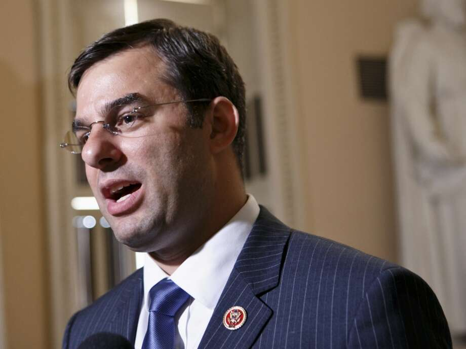 "Rep. Justin Amash, R-Michigan:  ""There's always revenue coming into the Treasury, certainly enough revenue to pay interest.  Democrats have a different definition of 'default' than what we understand it to be.  What I hear from them is, 'If you're not paying everything on time, that's a default.  And that's not the traditionally understood definition."" Photo: J. Scott Applewhite, AP"