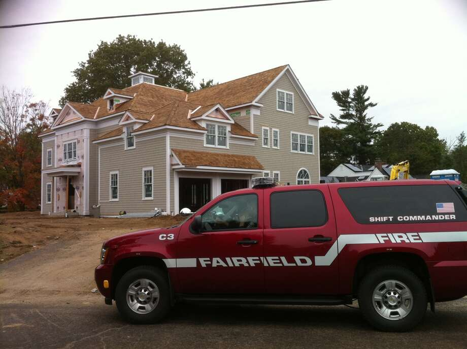 Four workers were injured when a staircase in a home under construction collapsed, trapping them in the basement.