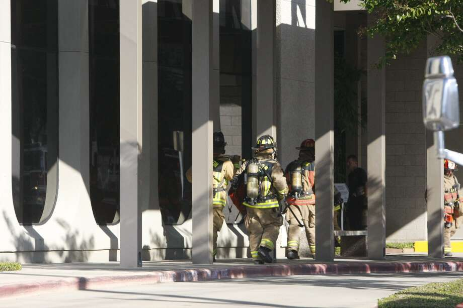Firefighters on Thursday quickly extinguished a two-alarm fire at the Council on Alcohol and Drugs Houston building at 303 Jackson Hill. Photo: Cody Duty, Houston Chronicle