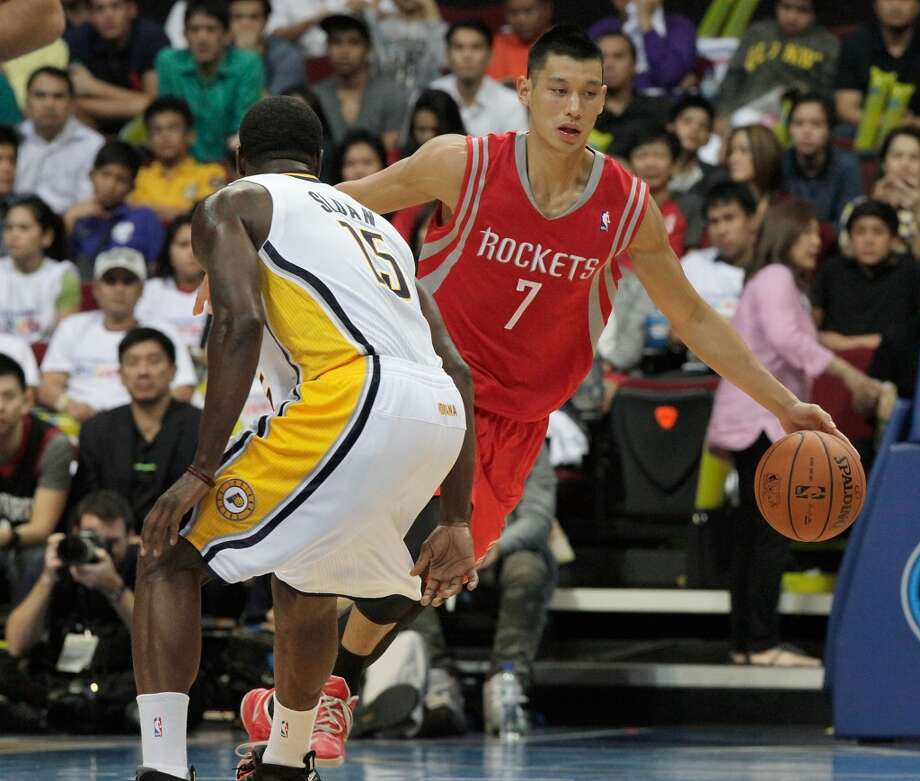 Rockets point guard Jeremy Lin dribbles as Donald Sloan of the Pacers defends. Photo: Mike Young, Getty Images