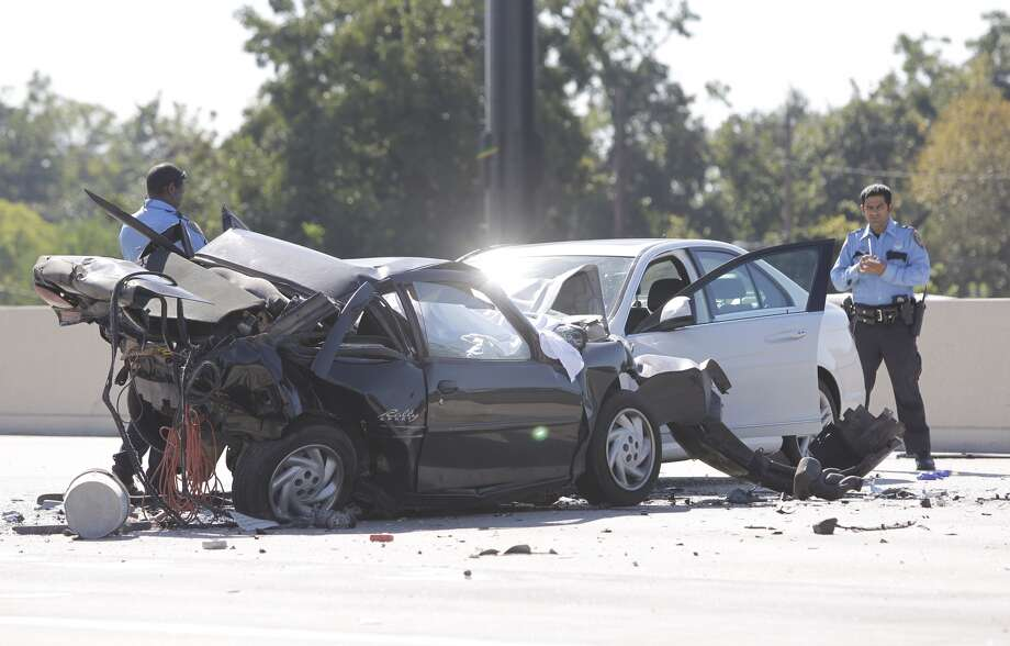 Police investigate at the scene of a wreck in the Westbound lanes of the North Loop near the Hardy Toll Road Thursday, Oct. 10, 2013. (Melissa Phillip/ Houston Chronicle) Photo: Melissa Phillip, Houston Chronicle