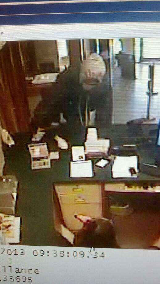 The suspect is described as a black male wearing a grey hooded sweatshirt, grey shirt, white shoes and dark-colored blue jeans.  He's described as a black male about 5-feet, 10-inches tall weighing approximately 165 lbs.  The man was last seen running northeast from the bank in the 700 block of Calder. Photo: None
