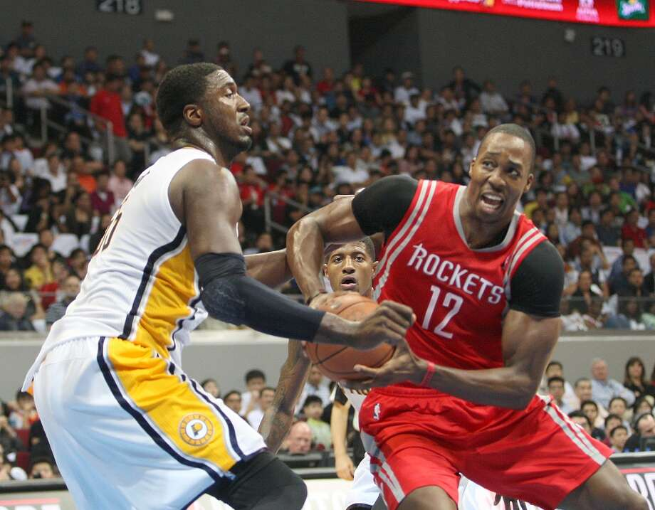 Dwight Howard of the Rockets drives against Roy Hibbert of the Pacers. Photo: Mike Young, Getty Images