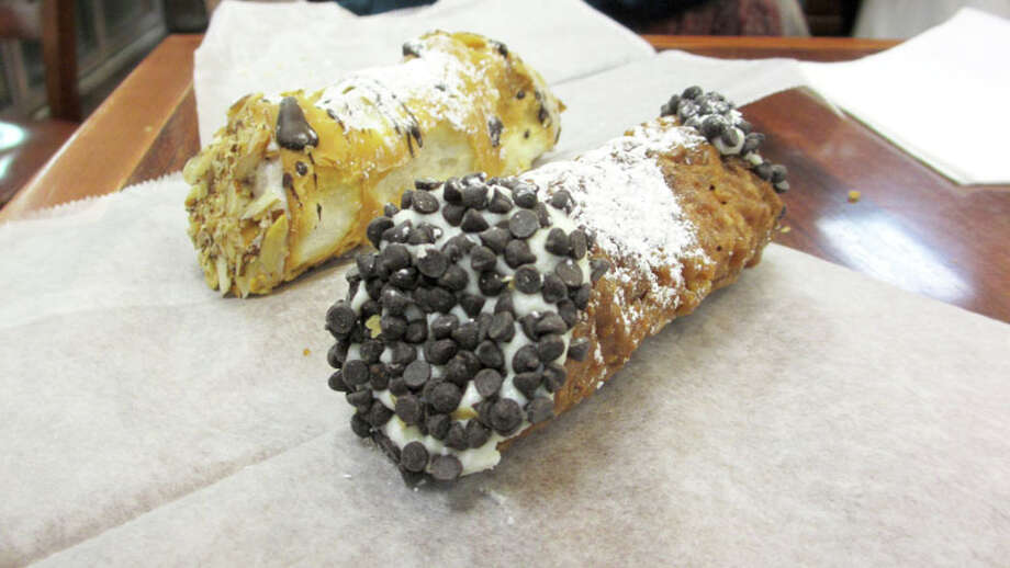 For dessert in Boston head to Mike's Pastry, 300 Hanover St. It will be easy to spot by the long line for cream-filled cannoli. Take your pick from among more than a dozen flavors. Amaretto and Florentine flavors pictured. Photo: Jennifer R. Lloyd, San Antonio Express-News