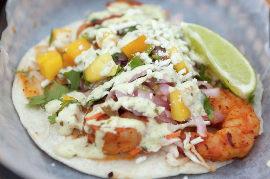 The monthly special called the Holy Diver is photographed at Torchy's Tacos on Sunday, April 22, 2012 in Houston, TX.  It comes with grilled achiote shrimp on a bed of cabbage topped with chopped mango, pickled onions, jalapenos, queso fresco, and cilantro.  ( J. Patric Schneider / For the Chronicle ) Photo: J. Patric Schneider, For The Chronicle / Houston Chronicle