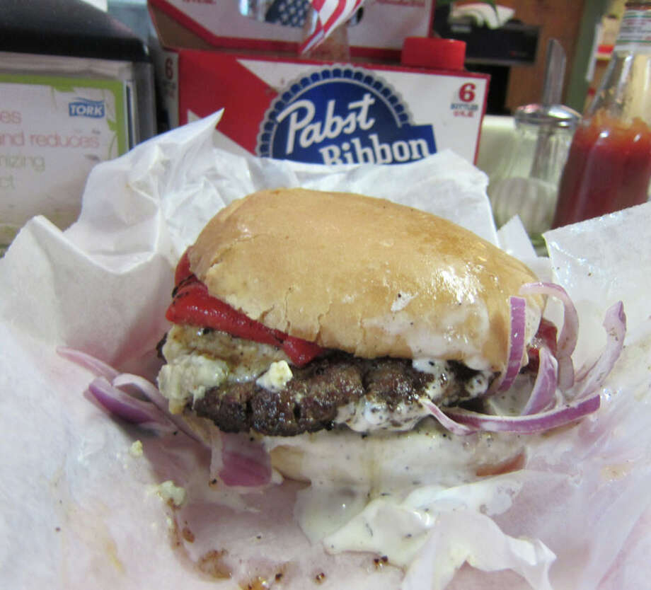 The Red, White and Blue Burger at Lankford Grocery. This burger is topped with roasted red bell pepper, red onion and blue cheese. Photo: Syd Kearney