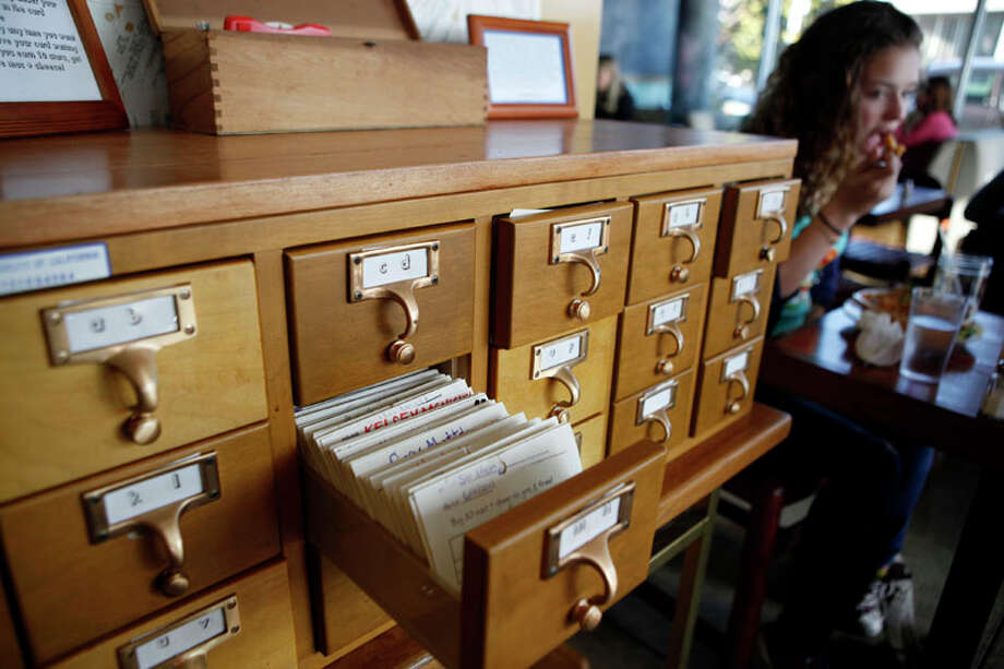 A library card filing cabinet is used to hold customer's frequent user cards at Homeroom restaurant on Wednesday, December 21, 2011 in Oakland, Calif. Photo: Beck Diefenbach, Special To The Chronicle / ONLINE_YES
