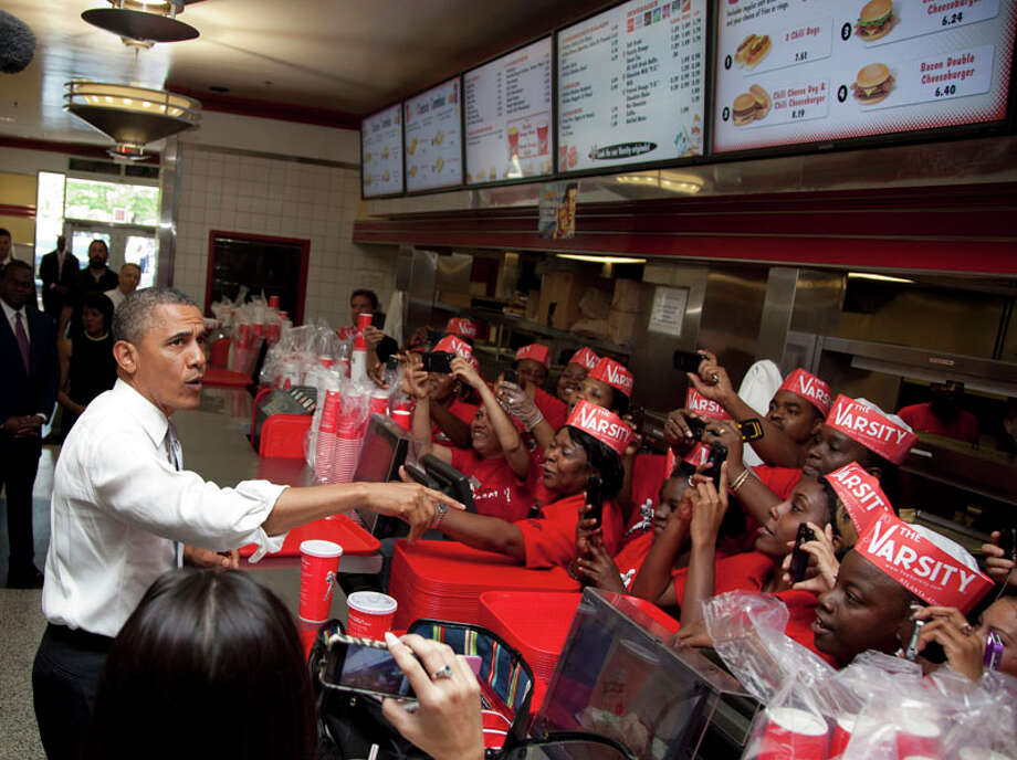 President Barack Obama places an order at The Varsity restaurant, Tuesday, June 26, 2012, in Atlanta. (AP Photo/Carolyn Kaster) Photo: Carolyn Kaster, Associated Press / AP