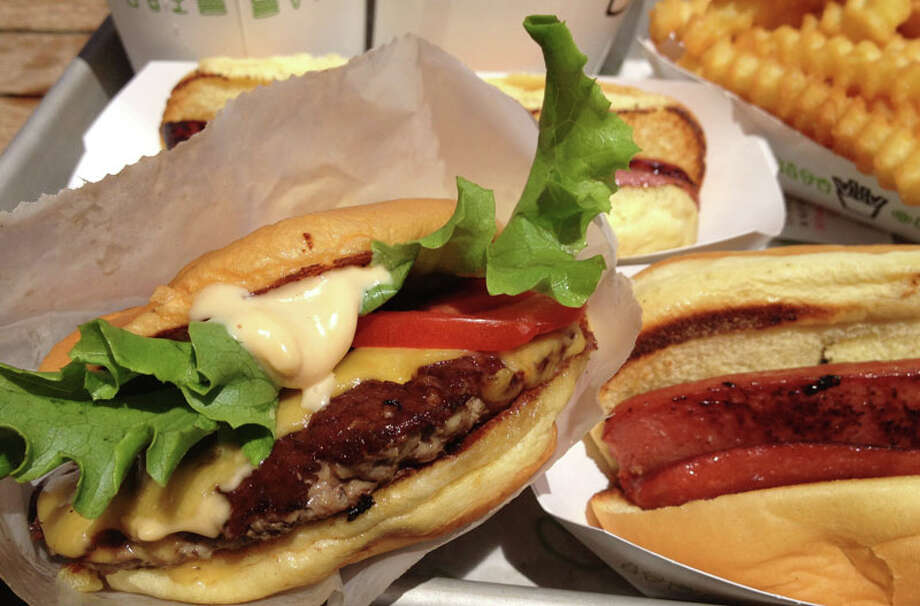 Shake Shack has re-imagined classic American burgers, dogs and fries with great success. The chain's Westport outlet remains busy two years after it opened. Photo: Patti Woods / Fairfield Citizen