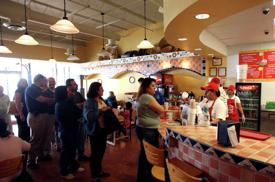 Customers line up to place their orders at the first Dona Tota Gorditas in San Antonio in 2007. Dona Tota Gorditas has 200 locations in Mexico. The San Antonio store is the first in the United States.  Photo: Robert McLeroy, San Antonio Express-News / San Antonio Express-News
