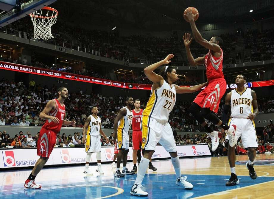 Robert Covington of the Rockets shoots over the top of Chris Copeland of the Pacers. Photo: Mike Young, Getty Images