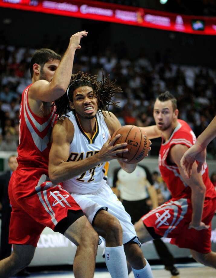 Chris Copeland of the Pacers drives against Rockets forward Chandler Parsons. Photo: NOEL CELIS, AFP/Getty Images