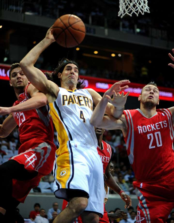 Donatas Motiejunas and Chandler Parsons of the Rockets defend Pacers forward Luis Scola. Photo: NOEL CELIS, AFP/Getty Images