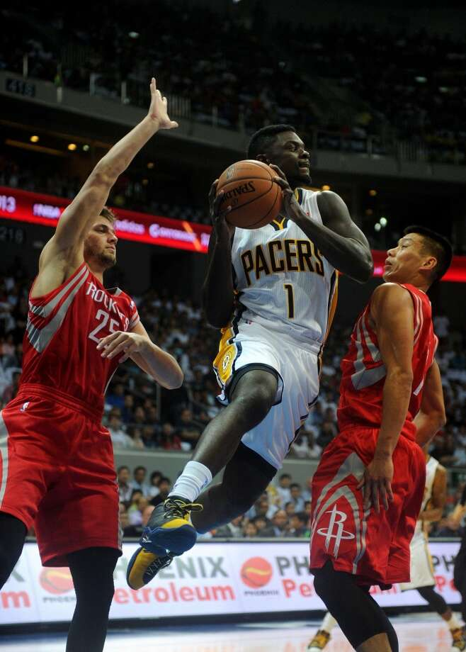 Lance Stephenson of the Pacers tries to score against Jeremy Lin and Chandler Parsons of the Rockets. Photo: NOEL CELIS, AFP/Getty Images
