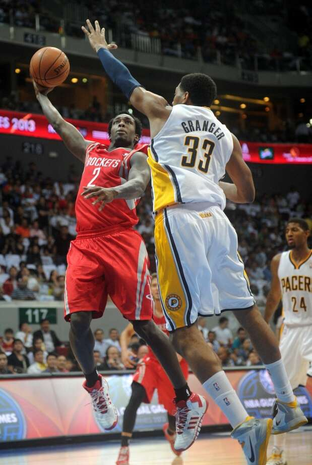 Patrick Beverley of the Rockets attempts a shot over Danny Granger of the Pacers. Photo: NOEL CELIS, AFP/Getty Images