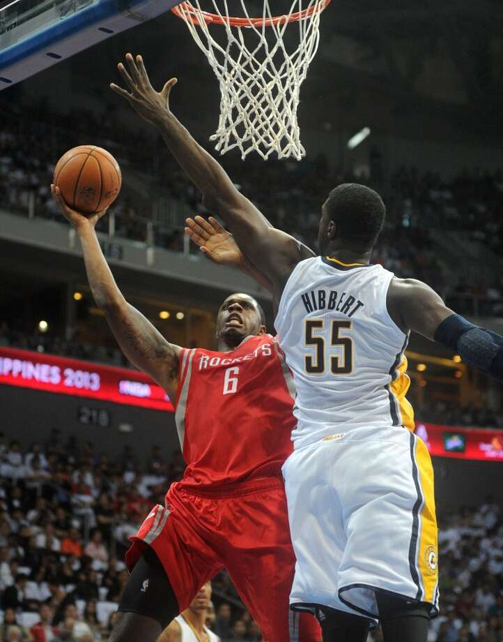 Pacers center Roy Hibbert attempts to block a shot by Rockets forward Terrence Jones. Photo: NOEL CELIS, AFP/Getty Images