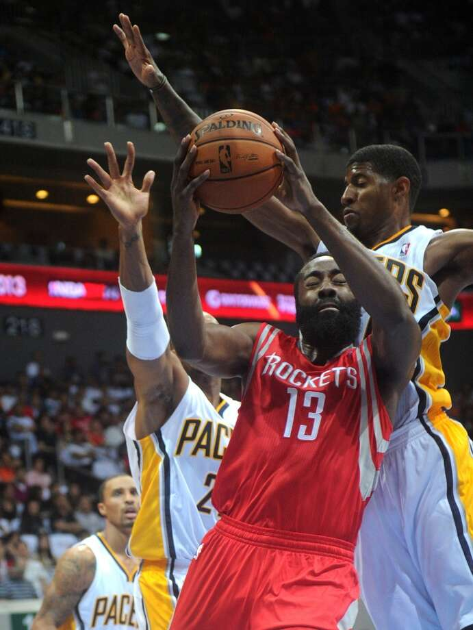 Rockets guard James Harden drives past Pacers guard Paul George. Photo: NOEL CELIS, AFP/Getty Images