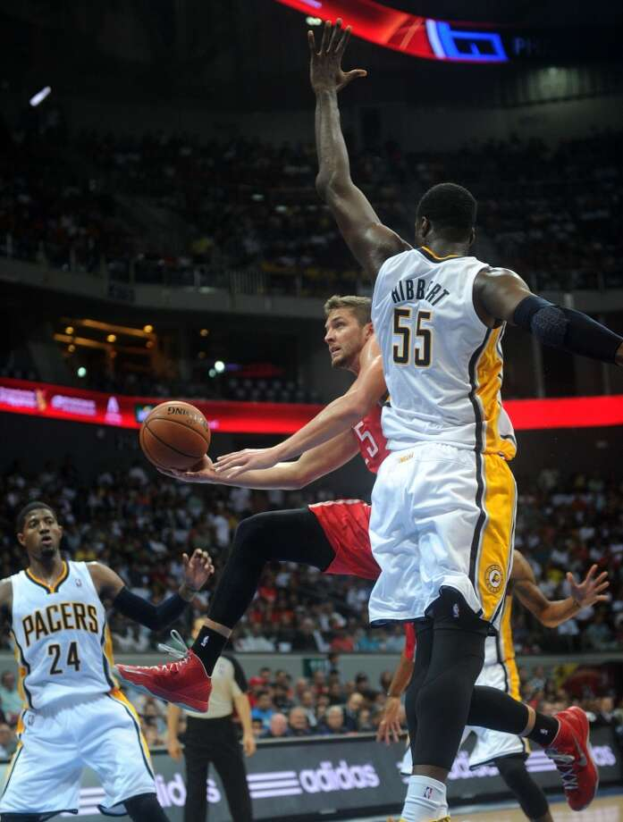 Roy Hibbert of the Pacers defends Chandler Parsons of the Rockets. Photo: NOEL CELIS, AFP/Getty Images