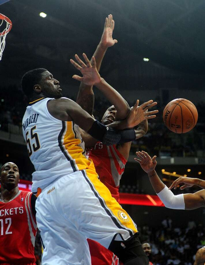 Roy Hibbert of the Pacers defends Terrence Jones of the Rockets. Photo: NOEL CELIS, AFP/Getty Images