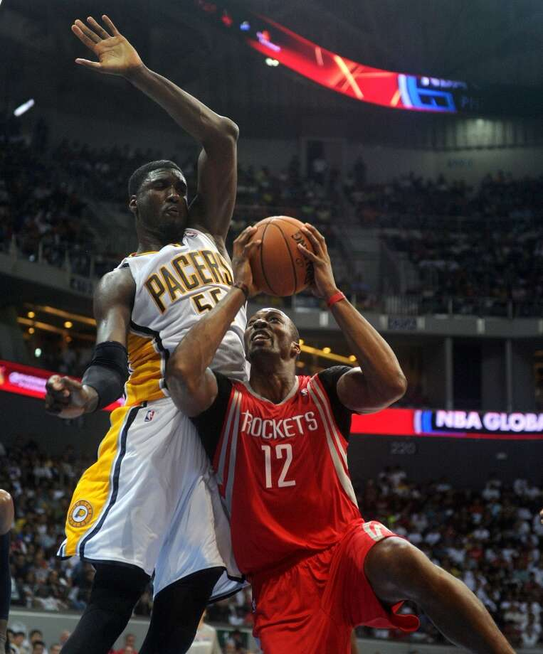Rockets center Dwight Howard tries to score against Roy Hibbert of the Pacers. Photo: NOEL CELIS, AFP/Getty Images
