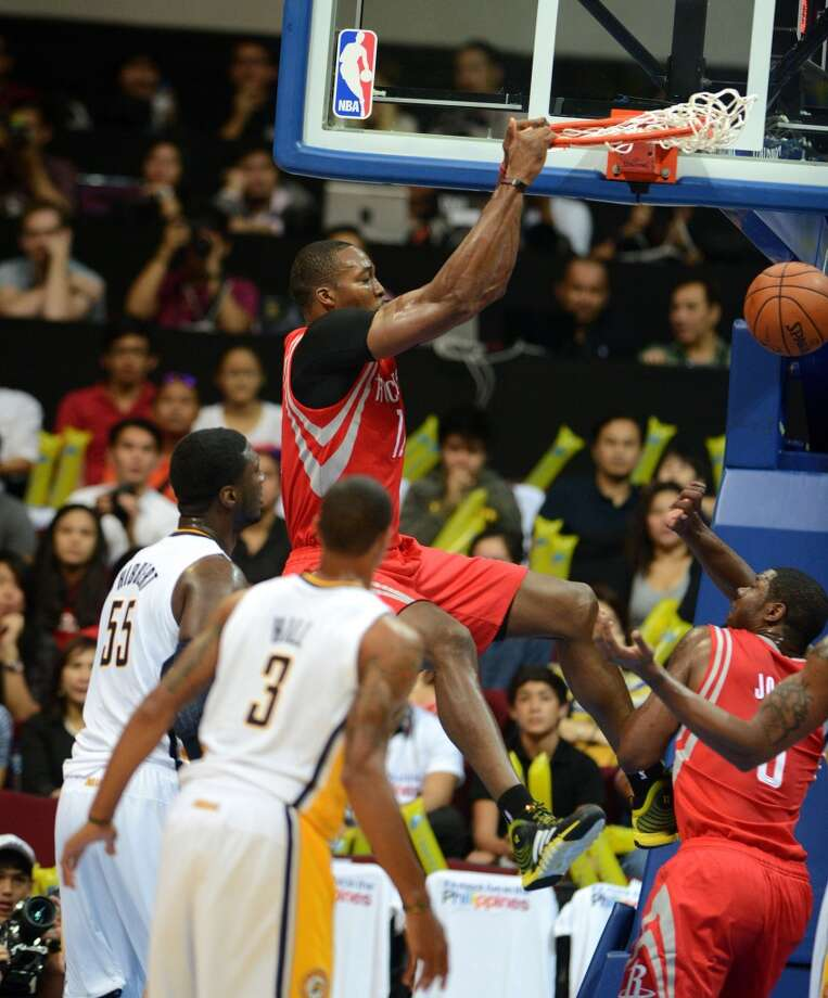 Rockets center Dwight Howard dunks against the Pacers. Photo: NOEL CELIS, AFP/Getty Images