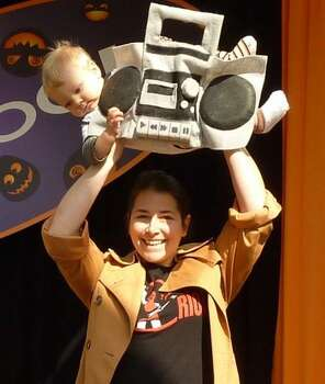 "SAY ANYTHING BOOM BOX (2012): Our group costume winner from last year -- the ''Mahna Mahna"" song has been replaced by ""In Your Eyes."" Nikki S. had a great response when asked why she dressed her 1-year-old son Teddy as a boom box. (''Because why not?'') He'll appreciate it when he's older. Photo: Courtesy Nikki S."