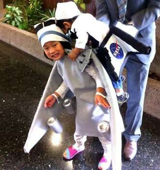 SPACE SHUTTLE ENDEAVOR (2012):  Longtime reader Rhean submitted this topical costume, which included her 4-year-old daughter as the jet that gave the Space Shuttle Endeavor (her 1-year-old brother)  victory tour ride across the state. There are great details here, but the girl's smile is the best. Photo: Courtesy Rhean