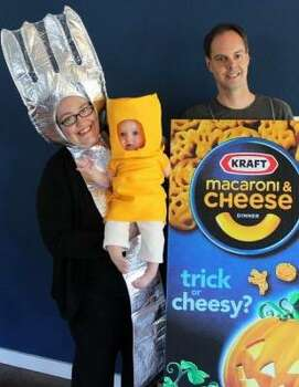 MACARONI AND CHEESE (2011): Ian, Monique, and baby Mina managed to adapt dad's hobby of collecting Mac and Cheese boxes into a group theme costume. Definitely the tastiest-looking family in contest history. Photo: Courtesy Ian, Monique, And Mina