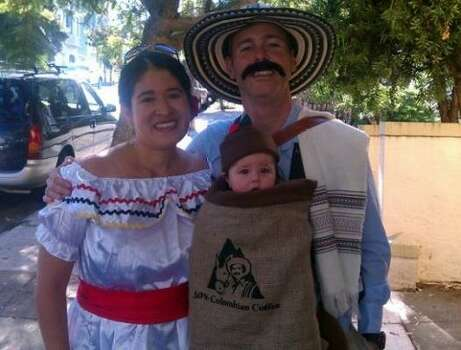 "JUAN VALDEZ (2011): Baby Catalina is in a burlap bag lined with felt attached to a baby bjorn. ""50% Colombian"" is in reference to Colombian-American mom and Texas-born dad."