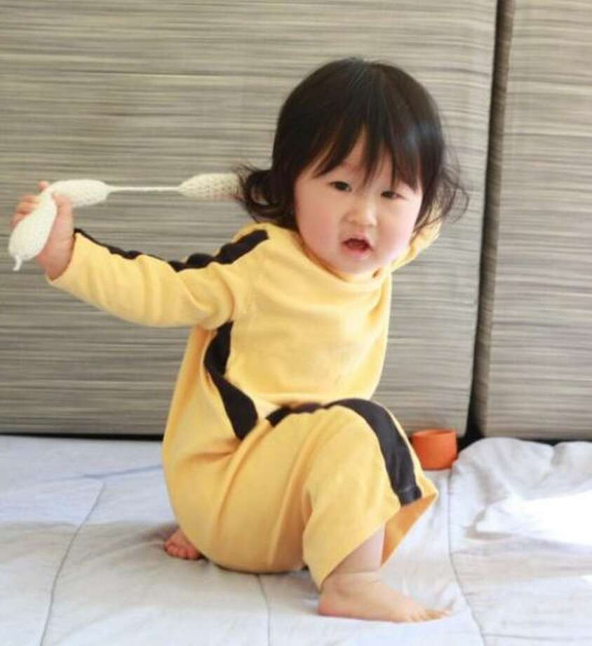 """BRUCE LEE (2009): Mom wanted it to be known that 1-year-old Ena Rudi was Bruce Lee, NOT Uma Thurman's bride character from """"Kill Bill."""" Either way, the knit nunchuks rule. Photo: Courtesy Jane"""