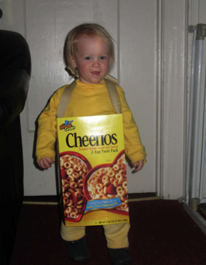 "CHEERIOS BOX (2007): I'm loving the ingenuity, after this early winner of our contest reportedly refused to put on her cat costume. (""Bye bye, kitty!"") That's what parenting is all about -- rolling with the punches and throwing together a makeshift Cheerios costume at the last minute. Photo: Courtesy Erin Merritt"