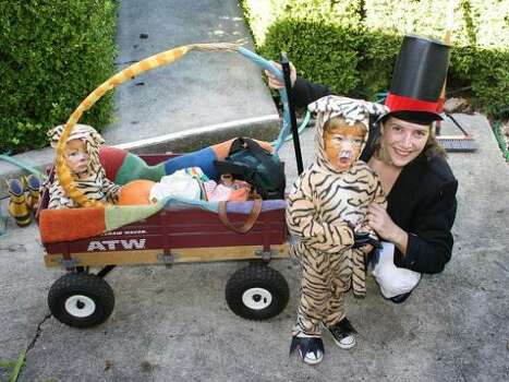 LION TAMER AND TIGERS (2010): I like how this whole theme came together -- Mother Gabriella worked on the kid costumes for a while, but her lion tamer costume was last minute. Photo: Courtesy Gabriella Raymond
