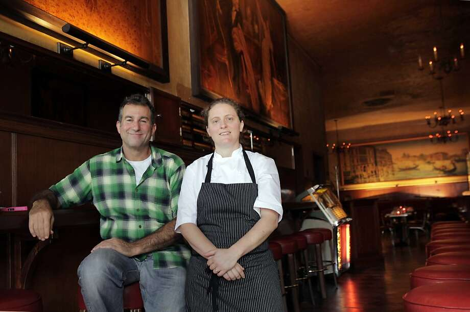 Ken Friedman, left, and April Bloomfield hope to reinvigorate business at Tosca with a new kitchen at the historic establishment. San Francisco's legendary Tosca is set to reopen this week under new ownership, featuring a restaurant as well as the bar. April Bloomfield of Spotted Pig helms the dining, and Co-owner Ken Friedman hopes the changes will bring back regulars and a new crowd. The San Francisco, Calif., mainstay is seen here on Monday, October 7, 2013. Photo: Carlos Avila Gonzalez, The Chronicle