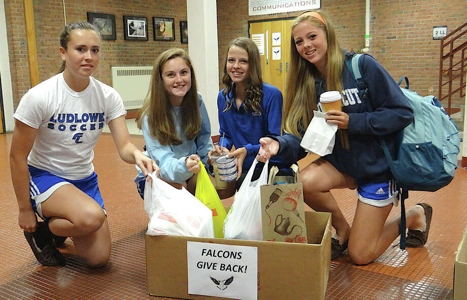Donating non-perishable foods to benefit Operation Hope are Fairfield Ludlowe High School students, from left, Lydia Hammond, 14, Charlotte Blatt, 15, Katherine Montanez, 15, and Samantha Lawrence, 15. Photo: Mike Lauterborn / Fairfield Citizen contributed