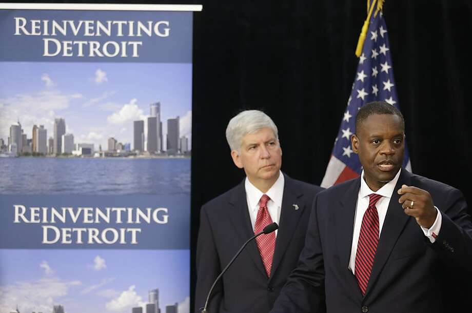 Michigan Gov. Rick Snyder (left) and Detroit's emergency manager, Kevyn Orr, speak at a news conference about Detroit's bankruptcy. The crisis has caused fear elsewhere. Photo: Carlos Osorio, Associated Press