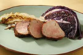 Spiced pork tenderloin with seared cabbage as seen in San Francisco, California, on Wednesday October 9, 2013. Food styled by Amanda Gold.