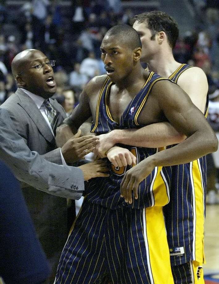 "What is now known as ""Malice at the Palace,"" Artest rushed the stands after a fan threw a cup of beer at him. What happened next was one of the ugliest moments in sports history as Artest and his teammates brawled with Detroit fans. Photo: Duane Burleson, Associated Press"
