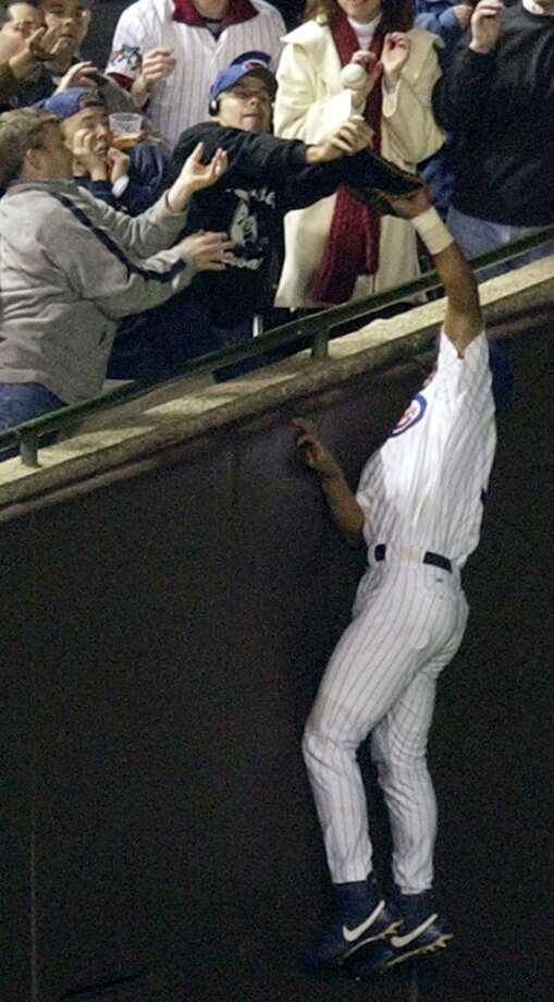 Steve Bartman, a lifelong Cubs fan, will be remembered for his mistake and not for his loyalty.  The Cubs were five outs away from reaching the World Series for the first time in 58 years. When outfielder Moisés Alou drifted into foul territory the ball was snatched up by Bartman.   The Cubs went on to lose the series and many blame Bartman for the team's bad luck. Photo: Amy Sancetta, Associated Press