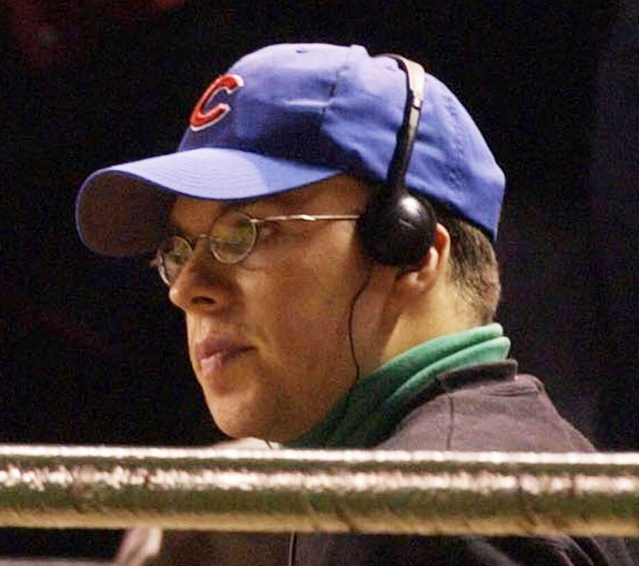 Bartman had to be escorted by security from Wrigley Field and then protected from angry Cubs fans after his name and address were made public. His green turtleneck and headphones are a universal symbol for fan interference. Photo: Scott Strazzantea, Chicago Tribune