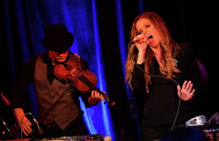 Lisa Marie Presley performs at 3rd & Lindsley during the 14th annual Americana Music Festival & Conference Sept. 20, 2013 in Nashville. Presley will perform at the Ridgefield Playhouse at 8 p.m. on Friday, Oct. 11, 2013. For more information, visit www.ridgefieldplayhouse.org. (Photo by Rick Diamond/Getty Images for Americana Music Festival) Photo: Contributed Photo / Stamford Advocate Contributed