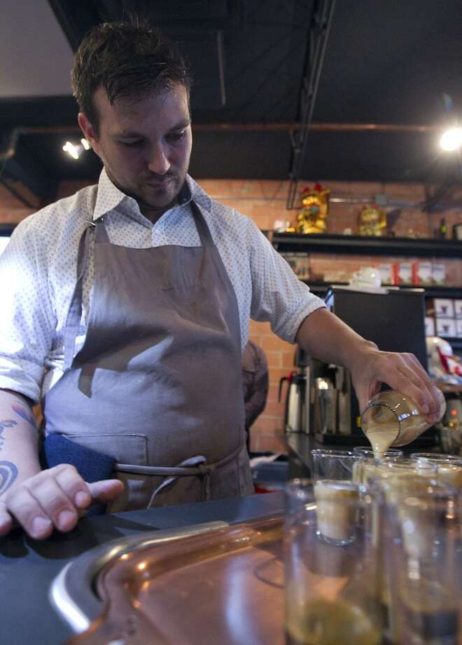 David Buehrer of Blacksmith coffee shop, practices for the Central Regional Barista Compeition in Minneapolis. ( James Nielsen / Houston Chronicle ) Photo: James Nielsen, Houston Chronicle