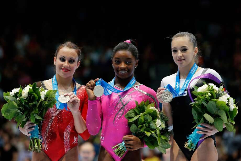 From left to right: Vanessa Ferrari (sliver) of Italy, Simone Biles (gold) of USA and Larisa Andreea Iordache (bronze) of Romania pose with their medals after the Floor Exercise Final on Day Seven of the Artistic Gymnastics World Championships Belgium 2013 held at the Antwerp Sports Palace on Sunday in Antwerpen, Belgium. Photo: Dean Mouhtaropoulos, Getty Images