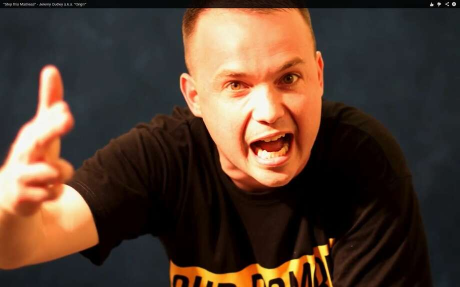 """A screen grab from the video of a rap song by Jeremy Dudley, aka Origin, called """"Stop the Madness"""" (Times Union)"""
