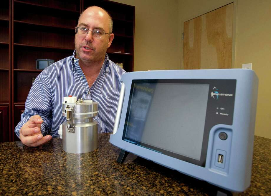 Bret Bader, CEO of Owlstone, talks in his Norwalk office about chemical detection devices made by the company on Thursday, October 10, 2013. Photo: Lindsay Perry / Stamford Advocate